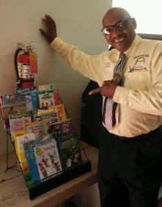 Pastor Ned Childress of Allen Chapel AME Church with his Little Library.